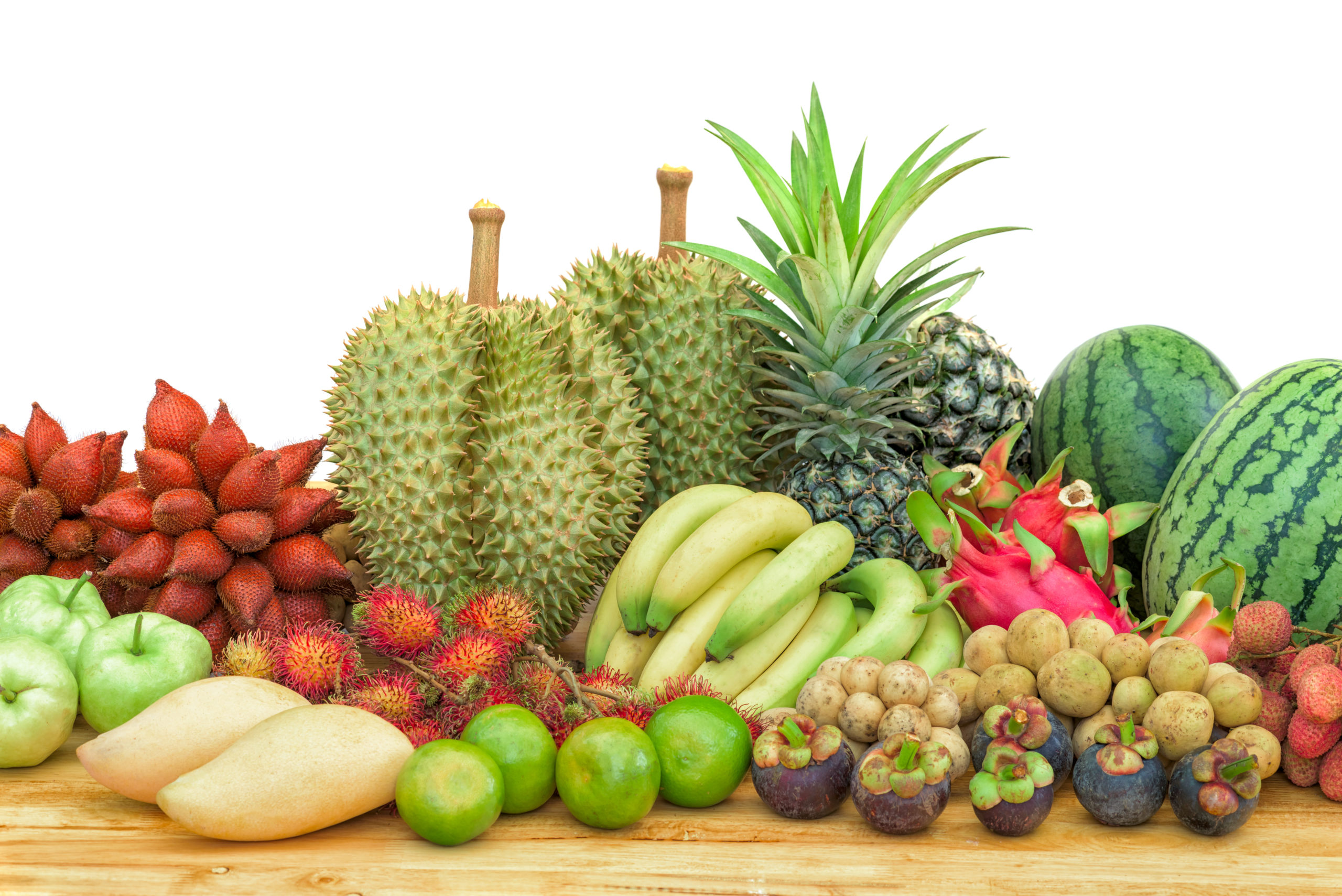 fresh mixed fruits on wood table isolated on white background.